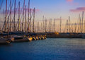 Sunset pier with boats and yachts scenic of a against the skies beautiful lighting Royalty Free Stock Image