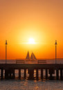Sunset, pier, sea, sailboat, benches, Key West, Keys, Cayo Hueso, Monroe County, island, Florida Royalty Free Stock Photo