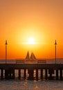 Sunset, pier, sea, sailboat, benches, Key West, Keys, Cayo Hueso, Monroe County, island, Florida Royalty Free Stock Photo