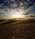 Sunset On Plowed Land Royalty Free Stock Photo