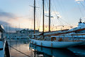 The sunset in port scenic view on moored yachts and old city of cannes on background france Royalty Free Stock Image