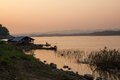 The sunset in the provinces of thailand house boat beside land Stock Photo