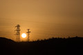 Sunset and pylons Royalty Free Stock Photo