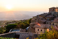 Sunset and Rays of Light in Small Town Volterra Royalty Free Stock Photo
