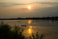 Sunset at the river mekong with boat running Royalty Free Stock Photography