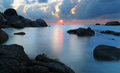 Sunset in rocky beach dramatic tanjung pandan belitung indonesia long exposure shot Stock Photo