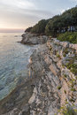 Sunset rocky beach in Istria, Croatia. Adriatic Sea, Lanterna peninsula. Royalty Free Stock Photo