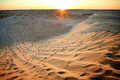 Sunset in Sahara desert Stock Images