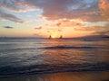 Sunset and sails between at waikiki beach Royalty Free Stock Photography