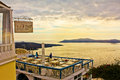Sunset in santorin over a restaurant santorini greece under cloudy sky Stock Image