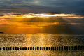 Sunset at the sea falling sunbeams over baltic in evening Royalty Free Stock Images