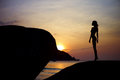 Sunset at sea figure of a girl in contre on the Royalty Free Stock Photography