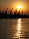 Sunset at the sea port industrial zone on Royalty Free Stock Photos