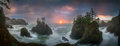 Sunset between Sea stacks with trees of Oregon coast Royalty Free Stock Photo