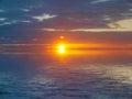 Sunset seascape orange with dark clouds Stock Photo