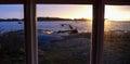 Sunset seen through a window with beach scenery Stock Photos