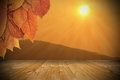 Sunset seen from wooden balcony autumn under a cherry tree Royalty Free Stock Photography