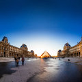 Sunset shines through the glass pyramid of the louvre museum paris france april and during on april in paris france Royalty Free Stock Image