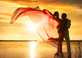 Sunset silhouette of couple in love on background Stock Image