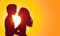 Sunset silhouettes of kissing couple Royalty Free Stock Photo