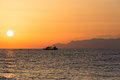 Sunset sky in the aegean sea with boat and mountains santorini Stock Photo
