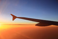 Sunset sky and airplanes wing view out of the window Royalty Free Stock Images