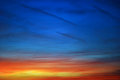 Sunset sky bright orange dark blue Stock Images
