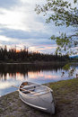 Sunset sky and canoe at Teslin River Yukon Canada Stock Image