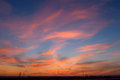 Sunset sky clouds orange electric power lines tower Royalty Free Stock Photo