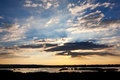 Sunset sky with clouds and river delta Royalty Free Stock Image