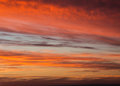 Sunset sky dramatic with orange colored clouds Royalty Free Stock Photo