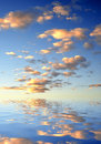 Sunset sky mirrored on water level Stock Image