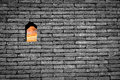 Sunset sky view in small window or hole on black and white brick Royalty Free Stock Photo