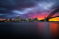 Sunset skyline of Sydney downtown  with Harbour Bridge, NSW, Aus Royalty Free Stock Photo