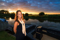 Sunset sloop woman beautiful standing next to a motor at in the netherlands Stock Photos