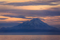 Sunset at the snow covered volcano in the cook inlet alaska colors clouds Royalty Free Stock Photography