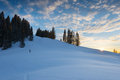 Sunset at snowy hill with wonderful sky and trees austria Royalty Free Stock Photo