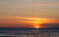 Sunset in the spring over thawing ice of gulf Royalty Free Stock Photography