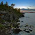 Sunset at stony shore of Ladoga lake Royalty Free Stock Photo