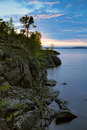 Sunset at stony shore of Ladoga lake Royalty Free Stock Image