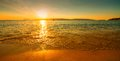 Sunset sunny beach at with boat Stock Images