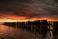 Sunset Sunrise waterfront old pier. Royalty Free Stock Photo