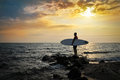 Sunset Surfer Silhouette Stock Images
