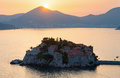 Sunset and Sveti Stefan sea islet (Montenegro) Stock Photo