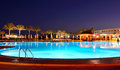Sunset and swimming pool at the luxury hotel Stock Photos