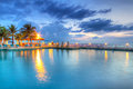 Sunset at swimming pool Royalty Free Stock Photo