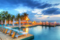 Sunset at swimming pool in thailand Royalty Free Stock Photography