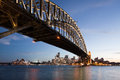 Sunset in sydney harbor bridge with downtown skyline at Stock Photos