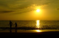 Sunset at tenerife couple in the sea playa de las americas spain Royalty Free Stock Images