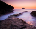 Sunset at trebarwith strand cornwall vibrant afterglow illuminates the wet rock on the north coast Stock Photography